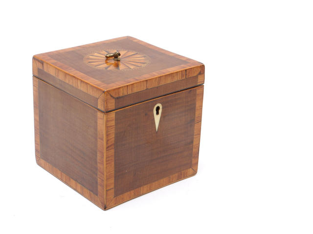 An early 19th century mahogany tea caddy