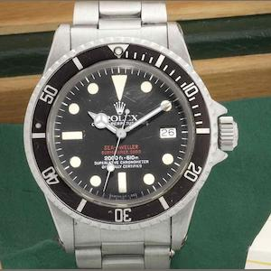 Rolex. A stainless steel automatic calendar bracelet watch 'Double Red' Sea-Dweller Mark IV, Ref:1665, Serial No.5225***, Retailed by Heinz Wipperfeld and sold 17th October 1979
