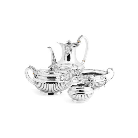 A Victorian matched four piece silver tea service By Walter & John Barnard, London 1895 & 1896
