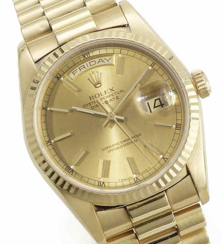 Rolex. An 18ct gold automatic calendar bracelet watch together with fitted presentation box and papers Day-Date, Ref:18238, Serial No.E447***, Sold 28th November 1991