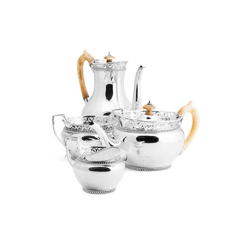 A four piece silver tea and coffee service By C.S.Harris & Sons Ltd., London 1910  (The hot water pot lid has detached which has resulted in damage to the pierced border)