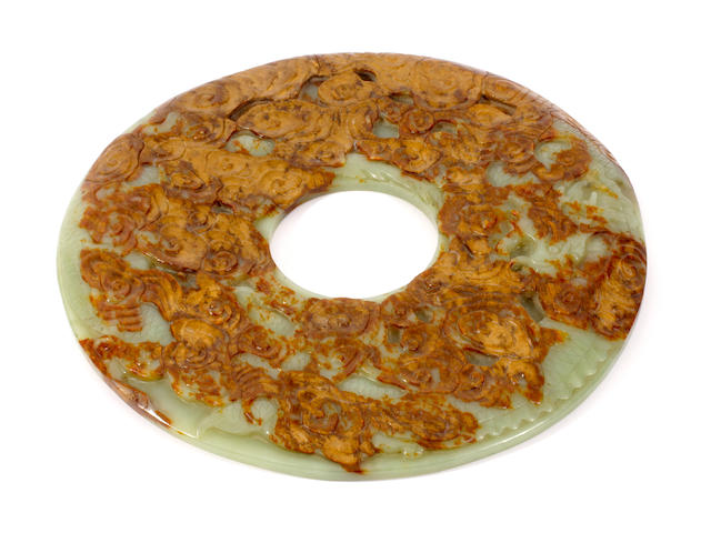 A Chinese mottled jade bi disc