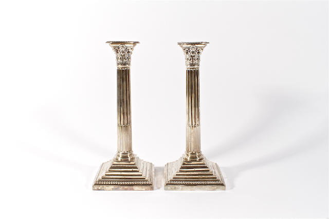 A pair late Victorian silver Corinthian column candlesticks by Hawksworth, Eyre and Co Ltd, London, 1898,  (2)