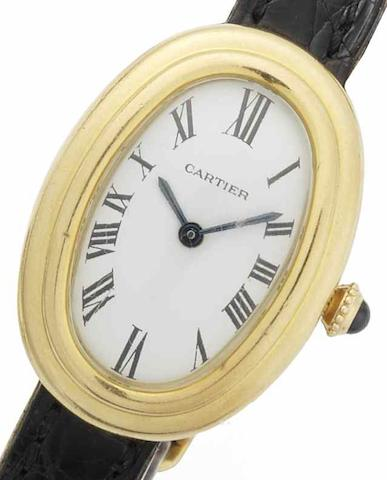 Cartier. An 18ct gold manual wind wristwatchBagnoire Oval, Circa 1970