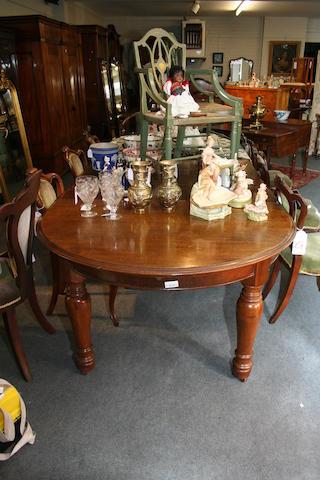 A Victorian oak extending dining table