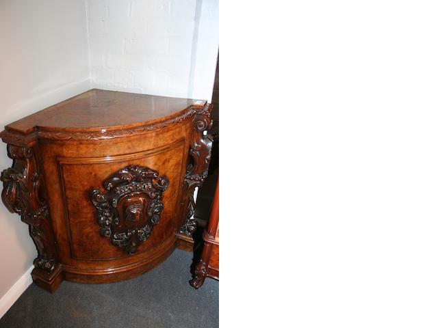 A Victorian burr walnut floor standing corner cupboard