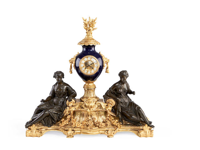 A late 19th century bronze, ormolu and porcelain mounted figural mantel clock