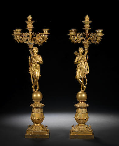 A pair of French Empire gilt bronze five-light candelabras of Diana and Apollo possibly by Thomire