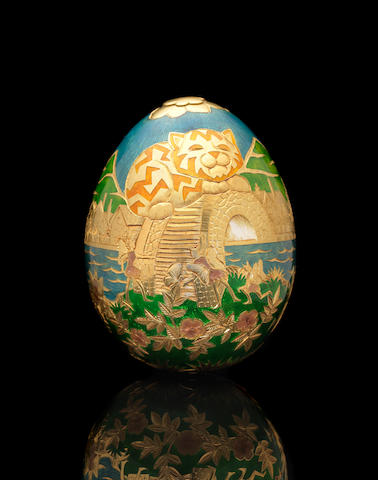 GARRARD: A cased 22 carat gold and enamelled Cadbury's 'Conundrum' egg maker's mark for Garrard & Co. Ltd, London 1983