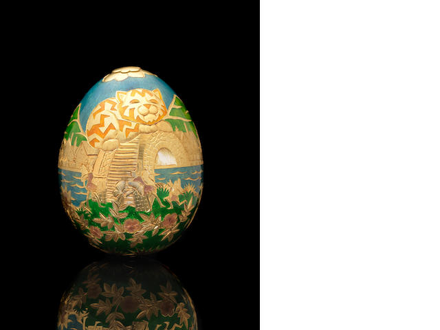 GARRARD: A cased 22 carat gold and enamelled  Cadbury's 'Conundrum' egg Maker's mark for Garrard & Co Ltd, London 1983