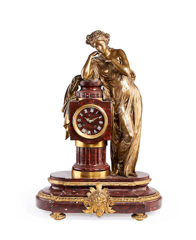 A third quarter 19th century French Rouge Griotte marble and gilt bronze figural clockby Charpentier, Paris