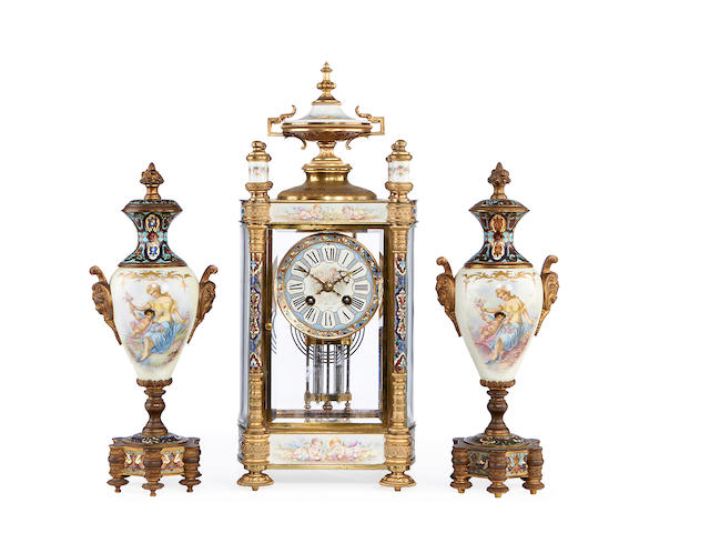 A late 19th century French gilt bronze, champleve enamel and Sevres style porcelain mounted clock garniture by Japy Freres