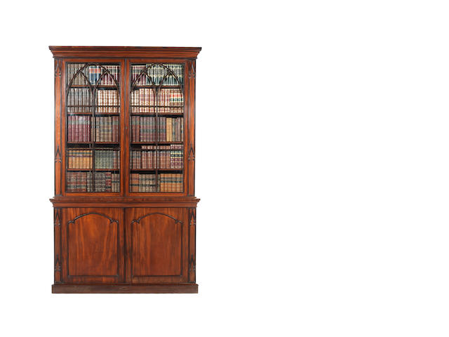 A George IV mahogany bookcase in the Gothic style