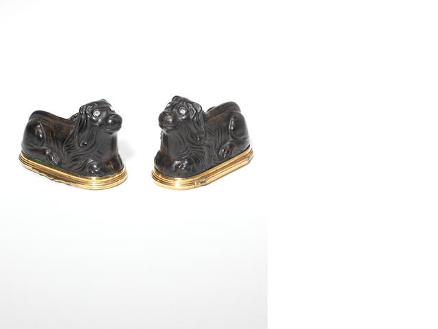 A pair of late 18th century tortoiseshell and gilt metal mounted lion snuff boxes Possibly German  (2)