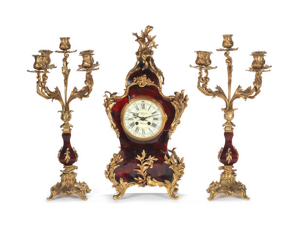 An Italian mid-19th century gilt-bronze and tortoiseshell three-piece clock garnitureby E. Baglia, Milano