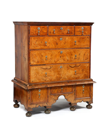 An early walnut chest on stand