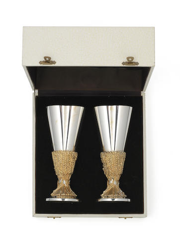 DESMOND GLEN MURPHY FOR AURUM: A cased pair of silver and silver-gilt  commemorative goblets, London 1975, together with a small square dish, by George Tarrant Ltd, designed by Geoffrey G Bellamy, London 1955,