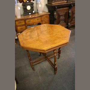 An octagonal walnut occasional table