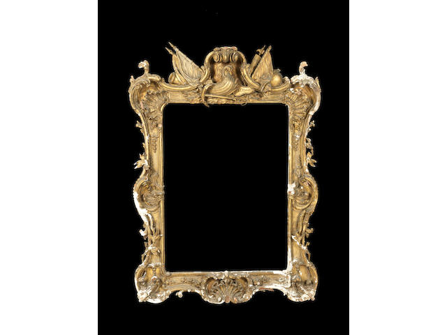 A large George III carved giltwood picture frame in the manner of Thomas Chippendale