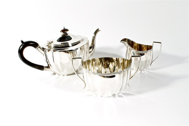 A silver three piece tea service by Charles Boyton and Sons, London, 1918,  (3)