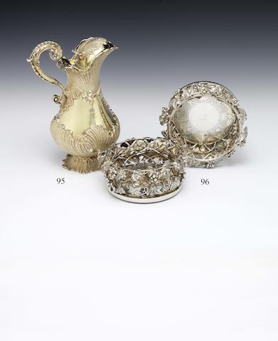 A pair of Victorian silver-gilt wine coasters by Charles Reily & George Storer, London 1845  (2)