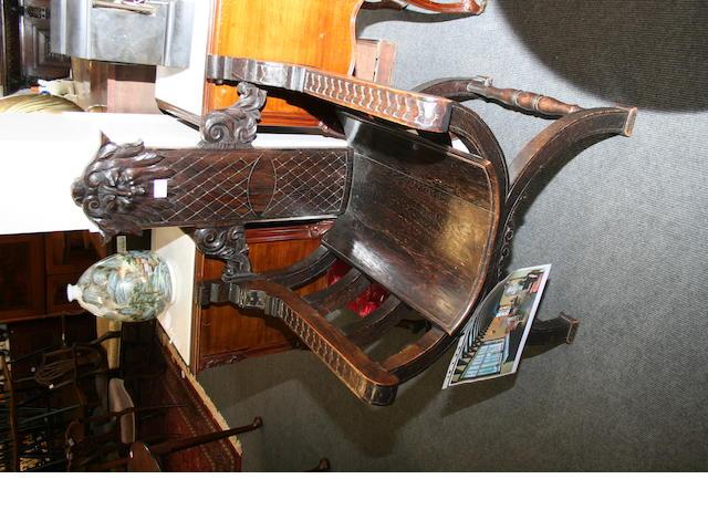 A late George III Sheraton-style mahogany open armchair