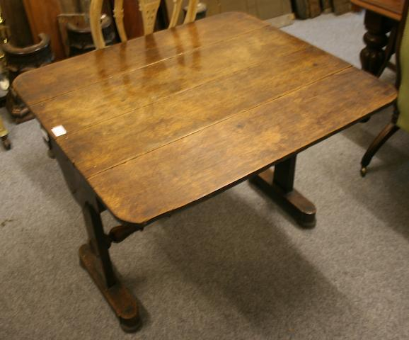 A 19th century oak twin-flap rounded rectangular top Pembroke-type table