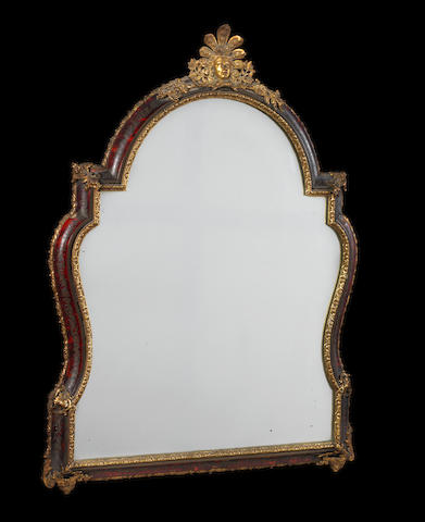 A 19th Century scarlet tortoiseshell and gilt metal mounted wall mirror