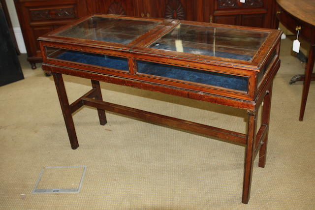 A late Victorian walnut and inlaid vitrine cabinet on stand