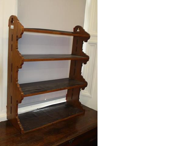 A set of 19th century oak Gothic Revival shelves