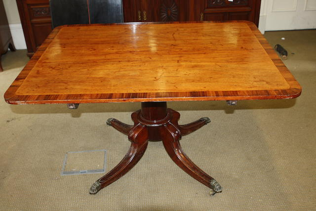 A Regency mahogany and rosewood cross banded snap-top centre table