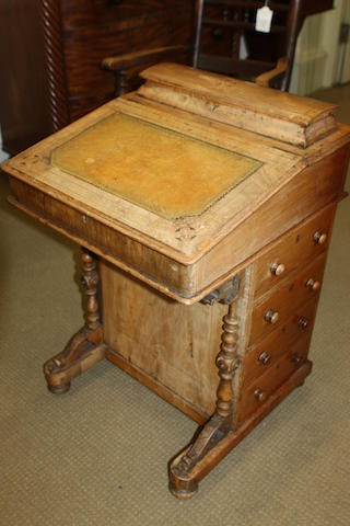 A late Victorian faded walnut and inlaid Davenport