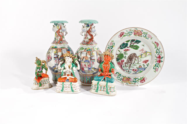 A pair of famille rose vases, a famille rose plate and three porcelain deities