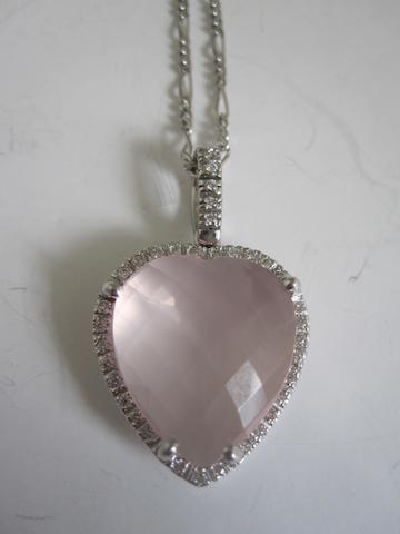 A rose quartz and diamond pendant