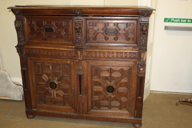 A 19th century carved oak cupboard