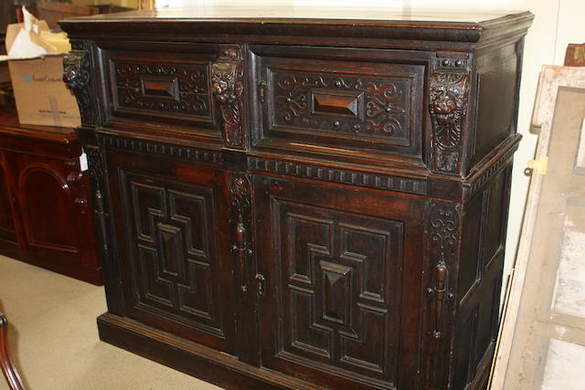 A 19th century oak cabinet in the 17th century style