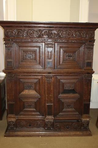 A 19th century Continental carved oak cupboard Possibly Dutch