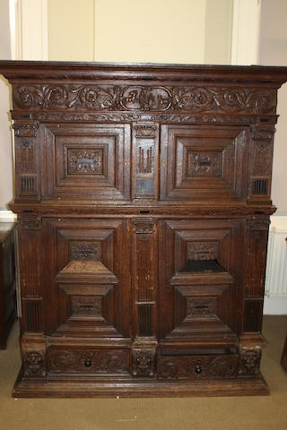 A 19th century Continental carved oak cupboard Possibly Dutch
