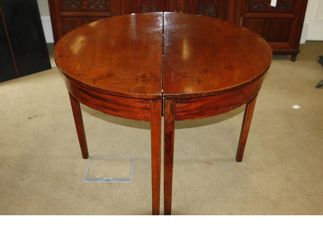 A 19th century mahogany D-end dining table