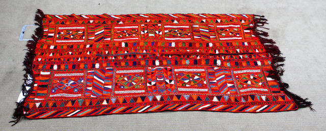 Two Turkish crewel-work wall hangings the hanging on red ground 137cm x 255cm, the hanging highlighted in pink threads 155cm x 191cm.