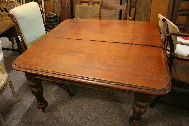 A mid-19th century mahogany extending dining table