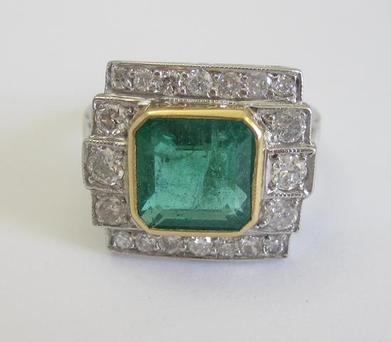 An emerald and diamond cluster ring