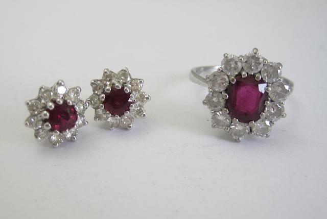 A ruby and diamond ring and a pair of ruby and diamond cluster earrings