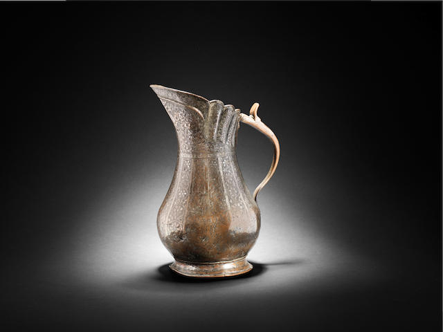 An engraved tinned-copper Jug Bukhara, Central Asia 18th/ 19th Century ??