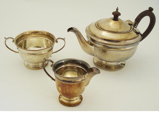 A three piece silver tea service By E W Haywood, Birmingham 1932