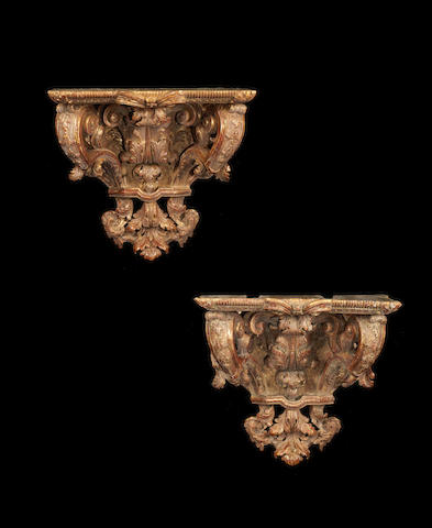 A matched pair of French giltwood wall appliques, one Régence, the other 19th century