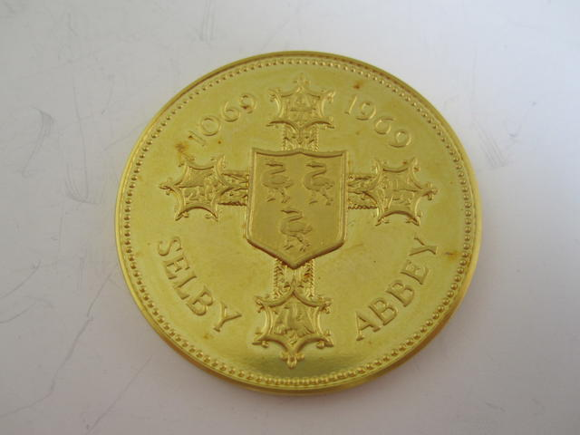 A 22ct gold Selby Abbey commemorative medal,