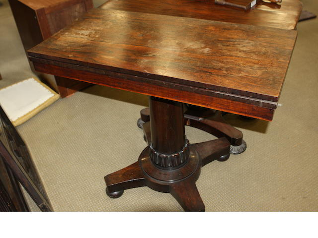 A mid 19th century rosewood pedestal tea table
