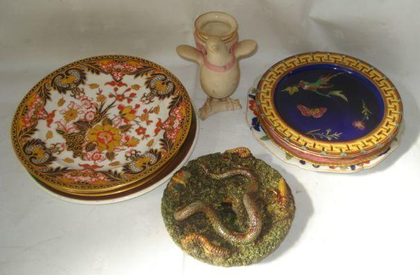 A Worcester Parian vase, in the form of a pink ribband dove, impressed factory mark, registration lozenge, a Portuguese shredded clay dish with snake, moth and insects, Ironstone plate, Longwy Art Deco plate and other plates