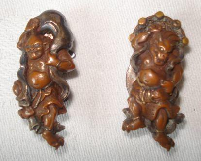 A pair of Japanese mixed metal collar studs, modelled as demons within swirling clouds.